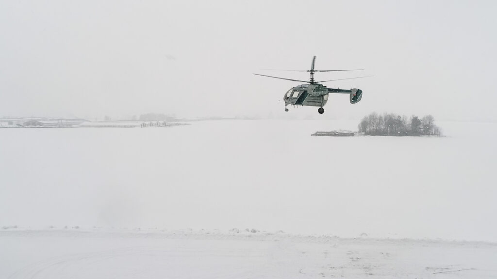 Unmanned helicopter flight with a 860kg load in extreme weather: frost, snowfall, limited visibility, and risk of icing